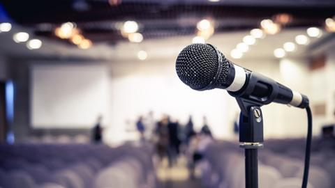 Microphone in Conference Seminar room Event Background